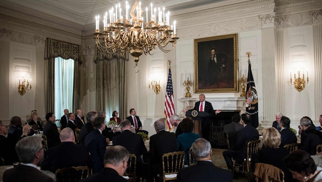 US President Donald Trump speaks to members of the National Governors Association and his administration before a meeting in the State Dining Room of the White House on February 27, 2017 in Washington, DC.