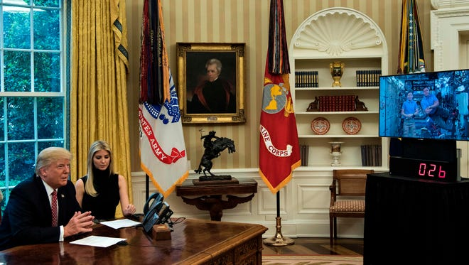 President Trump and Ivanka Trump speak with astronauts.