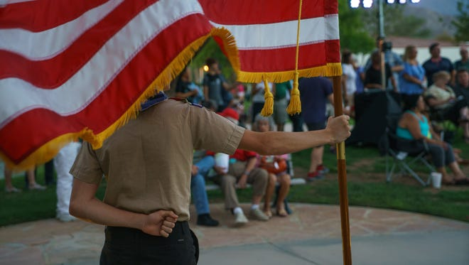 Alex Kueneman from Boy Scout Troop 377 of Bermuda Dunes holds the flag during a 9/11 vigil in La Quinta in 2016.