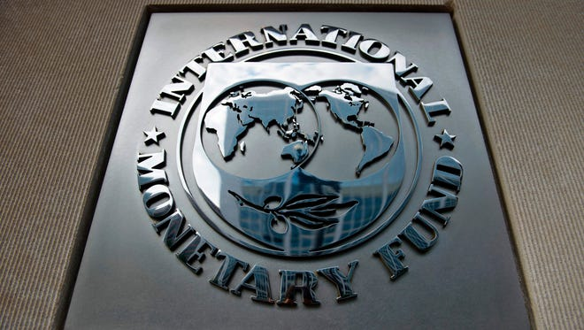 This file photo taken on June 30, 2015 shows the logo outside the headquarters of the International Monetary Fund in Washington, DC.