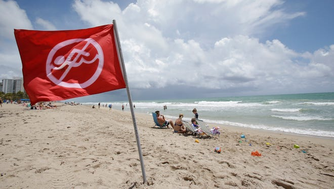 A no-swimming flag flies on the beach in May in Fort Lauderdale. Lifeguards put out red flags when there are dangerous currents.