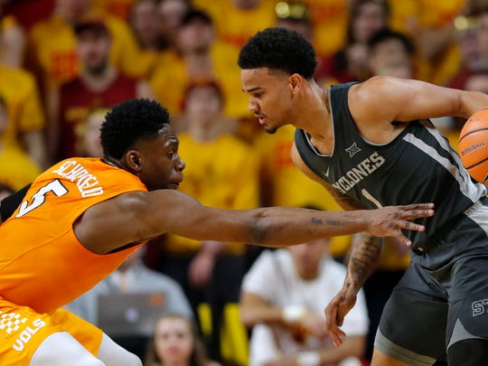 Tennessee forward Admiral Schofield, left, tries to steal the ball from Iowa State guard Nick Weiler-Babb, right, during the first half of an NCAA college basketball game, Saturday, Jan. 27, 2018, in Ames, Iowa. (AP Photo/Charlie Neibergall)