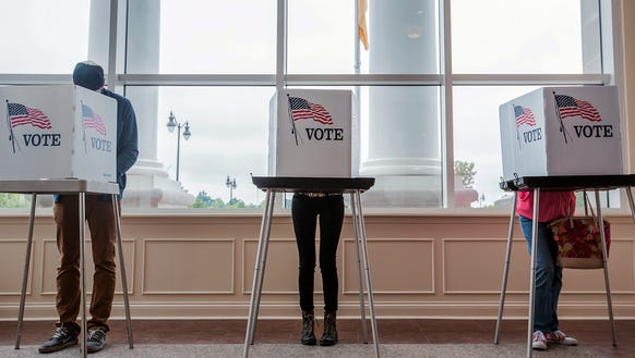 In this file photo, voters cast ballots in Paducah,
