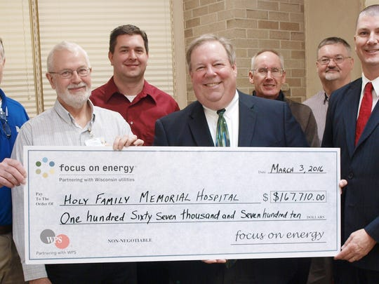 Focus on Energy recently presented Holy Family Memorial with an energy grant for $167,710 after its installation of a new energy efficient boiler system in the HFM Medical Center last year. Pictured, from left, is Wisconsin Public Service Corp.'s Jeff Henkelmann, HFM's Jerry Miller, Eric Braun, director and president and CEO Mark Herzog, Manitowoc Public Utilities' Dean Matzke and Dan Salm and Focus on Energy Richard Feustel.