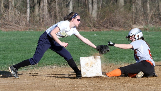 Pawling's Julia Krasinski kicks the base up as she beats the tag at second base by Vanessa Jacobs of Our Lady of Lourdes during a varsity softball game in Poughkeepsie April, 12, 2017. Pawling defeated Lourdes 1-0.