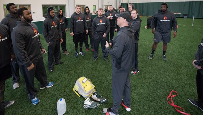 Players gather around during Ignition's Mock Combine at Wilmington College on Monday.