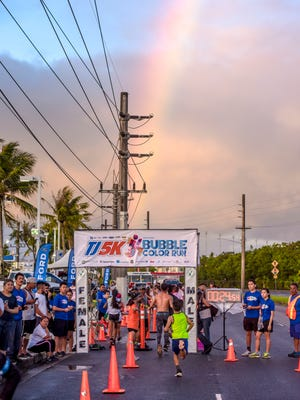 An early morning rainbow lead runners to the finish line of the 2017 Triple J 5K Bubble Color Run. On Saturday, northbound lanes of Marine Corps Drive will be closed from 4:30 to 8 a.m. for the race.
