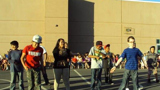 Kids dance at Beaver Dam school.