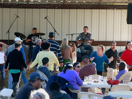 Visitors enjoy music and dancing during last year's