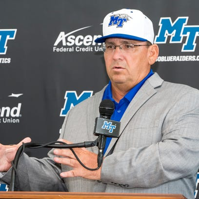Jim Toman talks to the media after being announced