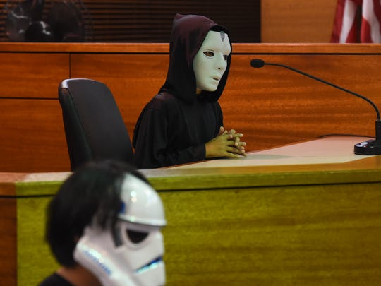 "Emperor Palpatine, played by Zander Barcinas, 10, takes the witness stand during a mock trial of ""The People v. Luke Skywalker"" at the Superior Court of Guam in Hagåtna on April 30, 2018."