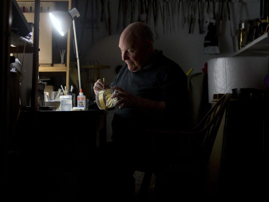 Glassblower William Gudenrath paints enamel on a bowl with techniques used by Renaissance Venetians at the Corning Museum of Glass. Gudenrath spent decades researching how Renaissance-era glassmakers produced objects that are now considered works of art.