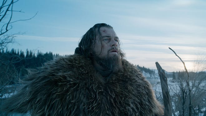 "This photo provided by courtesy of  Twentieth Century Fox shows Leonardo DiCaprio as Hugh Glass, in a scene from the film ""The Revenant."""