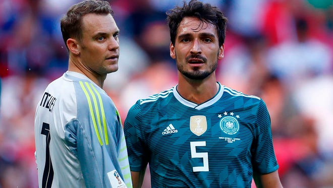 Germany goalkeeper Manuel Neuer and defender Mats Hummels look on after losing to South Korea.