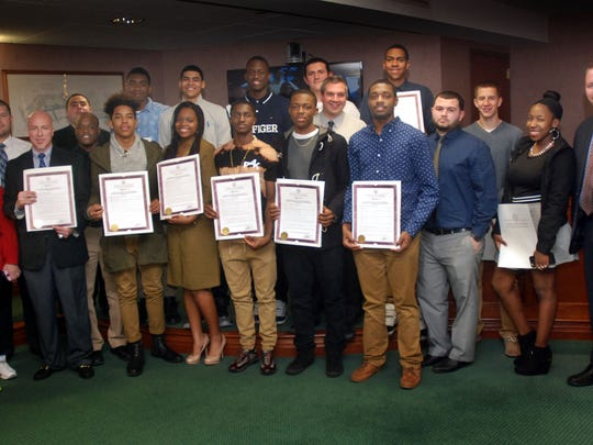 Union County Freeholder Christopher Hudak presents resolutions to the Linden High School Boys Basketball Team congratulating them on their outstanding 2015-16 season. The Linden Tigers, under the guidance of Head Coach Phil Colicchio, won 24 games while losing 6 and captured their fourth straight New Jersey Interscholastic Athletic Association North Jersey, Section Two, Group Four Title. Freeholder Hudak also presented Coach Colicchio a resolution congratulating him on achieving his 400th victory as a head varsity coach during the 2015-16 season at Linden High School.