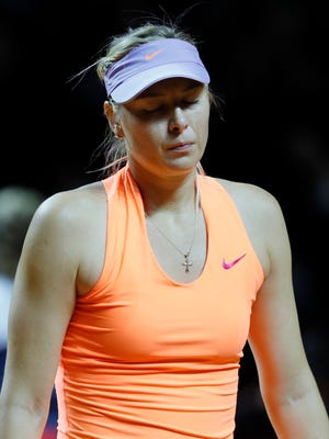 Maria Sharapova lost to Kristina Mladenovic in a semifinal match at the Porsche Tennis Grand Prix.