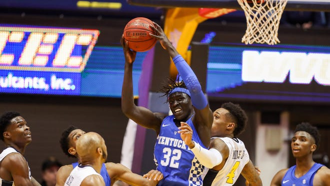 Kentucky Wildcats forward Wenyen Gabriel (32) grabs a rebound during the first half against the West Virginia Mountaineers at WVU Coliseum in Morgantown, West Virginia, on Saturday, Jan. 27, 2018.