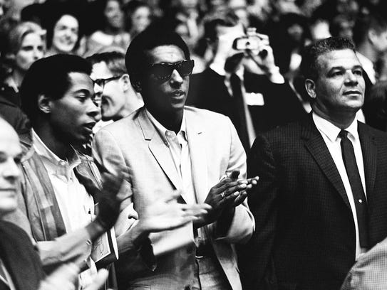 Stokely Carmichael, center, the militant leader of