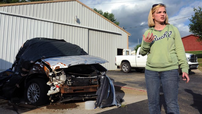 Stephanie Latier stands next to the remains of her Chrysler minivan at her parents' campground and talks about the crash that nearly took her life. On Feb. 18, she was driving to work on Ohio 37 near Millersport when she drifted left of center. Her front passenger side collided head-on with another vehicle. She suffered shearing of her spine and a fracture in her leg. Her brain injury was categorized as a diffuse axonal injury, which occurs when the brain shifts forward and backward in the skull. Shaken baby syndrome falls in the same category. To view more photos, visit www.zanesvilletimesrecorder.com.