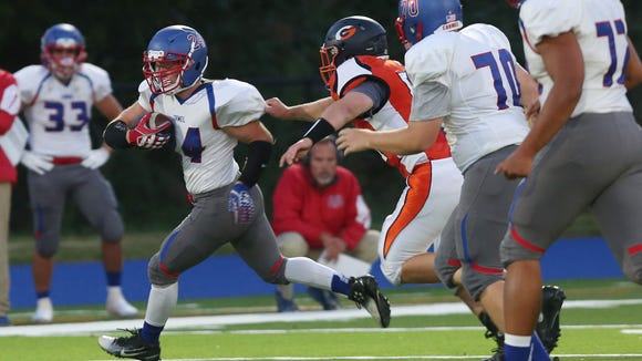 Carmel defeated Greeley 40-6 in football action at