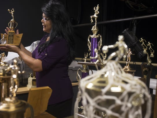 Patty Talahongva holds a trophy that will be on display
