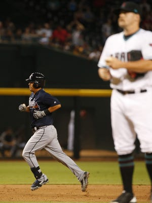 Atlanta Braves catcher Kurt Suzuki (24) rounds the bases after hitting a solo home run against Arizona Diamondbacks relief pitcher Andrew Chafin (40) during the eighth inning at Chase Field in Phoenix, Ariz. July 25, 2017.