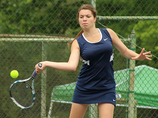 Blackman's Anna Mincey returns a shot during the Region