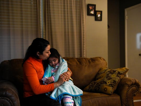 Abigail Velasquez comforts her daughter Melissa, 2, at their home in Nashville on Monday, March 19, 2018.