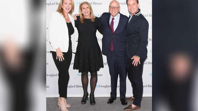 Douglas Elliman Real Estate agents Ashley McIntosh, left, and Christopher Leavitt, far right, joined company CEO Dottie Herman and Executive Chairman Howard Lorber at this week's Ellie Awards ceremony in Connecticut. Team Leavitt McIntosh tied for the No. 1 spot among the agency's Top 10 Teams based on gross commission income.