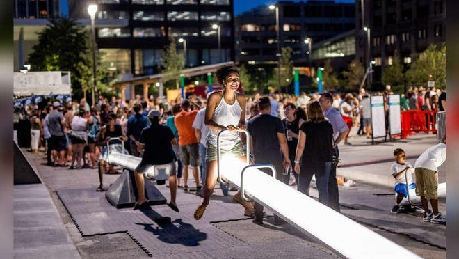 The interactive seesaws create light and music as they move.