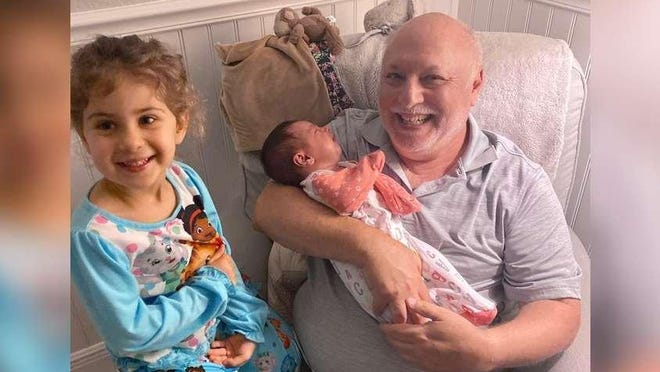 Perry Buchalter in early March 2020 in Jupiter, with granddaughters Raya (left) and Leah. He died of COVID-19 on April 7.