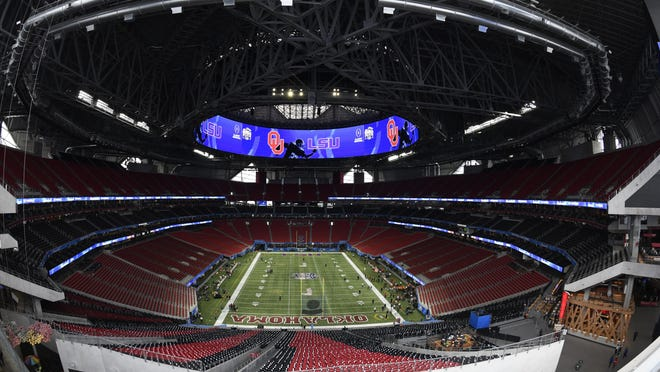 Mercedes Benz Stadium, shown before the Peach Bowl game between LSU and Oklahoma on Dec. 28, 2019 in Atlanta, will have smaller capacity for Falcons games because of the coronavirus pandemic, the Falcons announced Wednesday.