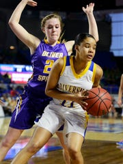 Riverside's Deidre McElrath is guarded by Oliver Springs'