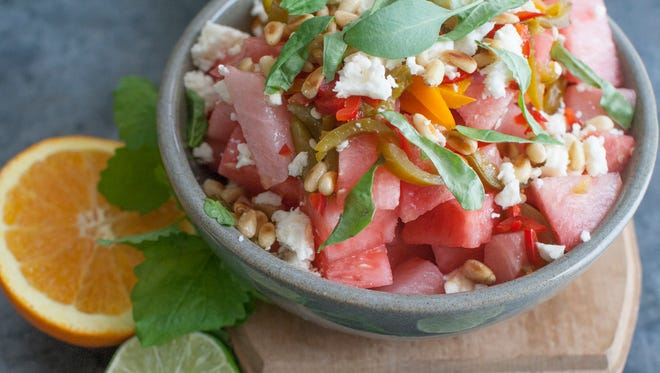 Spicy watermelon salad with feta and basil in Concord, N.H. on June 30, 2014.