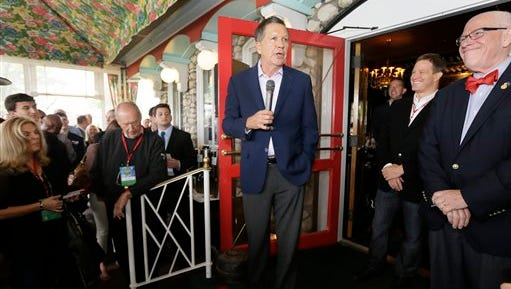 Ohio Gov. John Kasich says he doesn't associate Latinos with service jobs. He made the comments on the sidelines of the Mackinac Republican Leadership Conference, Saturday, Sept. 19, 2015, on Mackinac Island, Michigan. (AP Photo/Carlos Osorio)