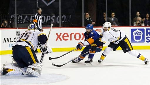 The Islanders' Nick Leddy (2) gets past the Predators' Ryan Ellis (4) as goalie Pekka Rinne (35) defends in the second period Thursday.