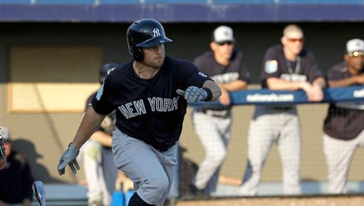 New York Yankees' Brett Gardner bats against the Washington Nationals in a spring training baseball game, Wednesday, March 23, 2016, in Viera, Fla.