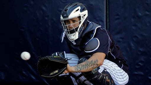 New York Yankees catcher Gary Sanchez prepares to catch the ball in the bullpen during a spring training baseball workout Friday, Feb. 19, 2016, in Tampa, Fla.