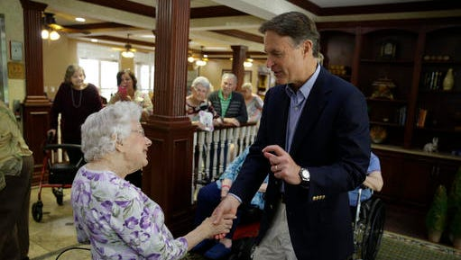 FILE - In this Aug. 30, 2016, file photo, Democratic U.S. Senate candidate Evan Byah talks with Claire Rothenbuhler as he campaigned in a senior living community in Indianapolis. Bayh was Democrats' prize Senate recruit this election cycle, a popular former senator and governor with a huge war chest and sky-high name ID in his home state. Top Democrats heralded his surprise entrance into the race in July with hopes that Republicans would abandon his little-known and underfunded GOP rival, Rep. Todd Young, and give up on Indiana. Instead, outside GOP groups including the Chamber of Commerce and the billionaire Koch Brothers have poured some $10 million into the race, eroding Bayh's fund-raising advantage and closing his lead over Young to low- or mid-single digits.  (AP Photo/Michael Conroy, File)