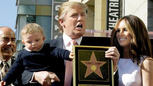 "FILE - In this Tuesday, Jan. 16, 2007 file photo, Donald Trump, billionaire developer and producer of NBC's ""The Apprentice,"" with his wife, Melania, and their son, Barron, pose for a photo after he was given a star on the Hollywood Walk of Fame in Los Angeles."