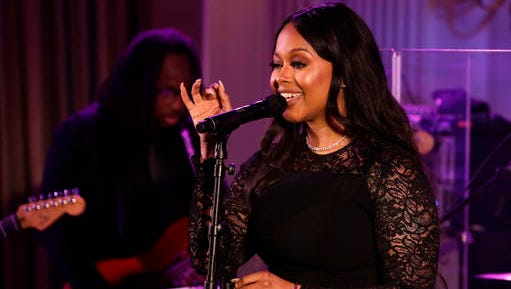 FILE - In this Aug. 2, 2016, file photo, singer Chrisette Michele performs for President Barack Obama, first lady Michelle Obama, Singapore's Prime Minister Lee Hsien Loong, and his wife Ho Ching, in the State Dining Room of the White House during a state dinner in Washington. The New York Daily News reported on Jan. 18, 2017, that Michele would perform at President-elect Donald Trump's inauguration Jan. 20, 2017.