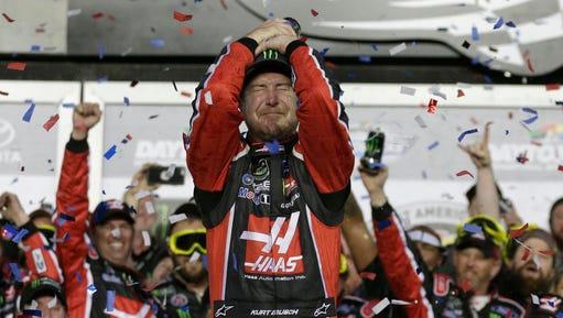 Kurt Busch celebrates in Victory Lane after winning the NASCAR Daytona 500 auto race at Daytona International Speedway in Daytona Beach, Fla., Sunday, Feb. 26.
