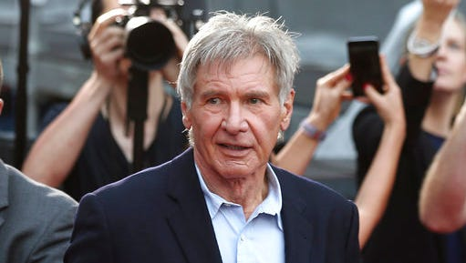 FILE - In this December 10, 2015 file photo, Harrison Ford greets fans during a Star Wars fan event in Sydney, Australia. Ford told an air traffic controller he was distracted and concerned about turbulence from another aircraft when he mistakenly landed his small plane on a taxiway at a Southern California airport in Feb. 2017.