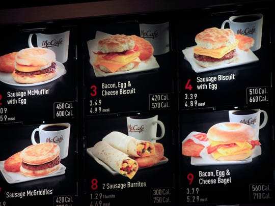 Items on the breakfast menu, including the calories, are posted at a McDonald's restaurant in New York.