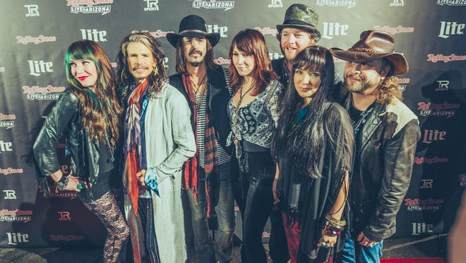 Musical legend Steven Tyler and his band pose on the red carpet at the Rolling Stone Super Bowl party, Jan. 31, 2015.