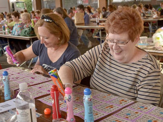 Phyllis Redfern, right, and daughter Debbie Krone play Bingo at a past Fall Festival. Bingo is 6-9 p.m. Friday, Sept. 9, at The Gathering.