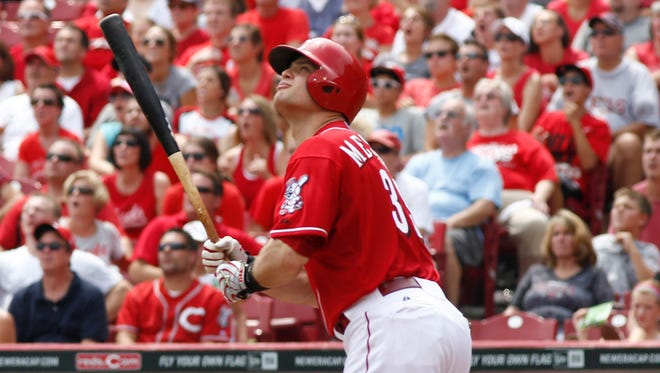 Cincinnati Reds' Devin Mesoraco watches his grand slam  homer off Miami Marlins starting pitcher Brad Hand in the fifth inning of a baseball game, Sunday.