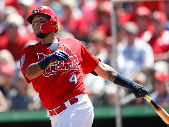 St. Louis Cardinals' Yadier Molina (4) drives in a run with a double in the fifth inning of a spring training baseball game against the Miami Marlins, Friday, March 16, 2018, in Jupiter, Fla. (AP Photo/John Bazemore)
