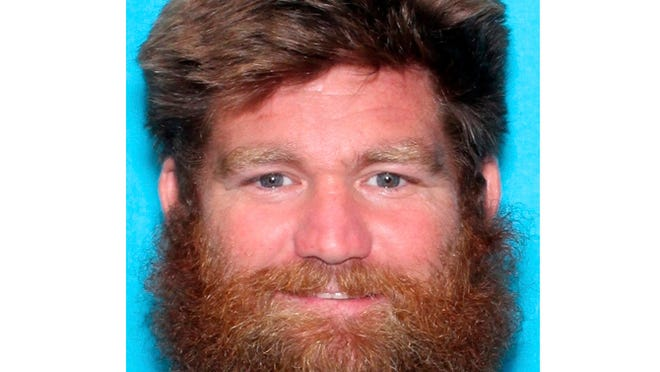 This photo provided by the Kansas Bureau of Investigation shows Donny Jackson. Authorities are looking for two girls who were abducted from a Kansas home where two boys were found dead Saturday, Oct. 24, 2020. An Amber Alert said the suspect in the abduction is the girls' father, 40-year-old Donny Jackson.