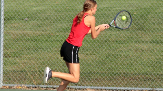 Senior Megan Sisson of the 2020 Chillicothe (Mo.) HS tennis Lady Hornets charges in and to her left to reach a Cameron shot and deliver a sensational cross-court, backhand winner during Monday's 8-2 No. 1 doubles victory with classmate Delaney May during the semifinals of the Class 1 District 15 team tournament. Chillicothe won the match over the Lady Dragons 5-0 to earn the right to host Tuesday's (Oct. 6) championship match against either Trenton or Kirksville at 4 p.m. at the Daryl Danner Memorial Park courts.
